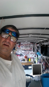 Craig Wilusz with his truck loaded with GPS gear.